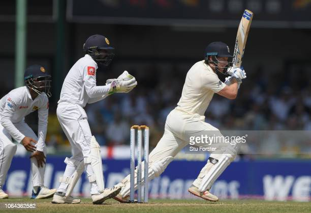 England batsman Jonny Bairstow drives for runs during Day One of the Third Test match between Sri Lanka and England at Sinhalese Sports Club on...