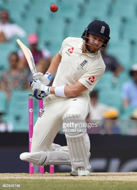 England batsman Jonny Bairstow ducks a bouncer on the final day of the fifth Ashes cricket Test match against Australia at the SCG in Sydney on...