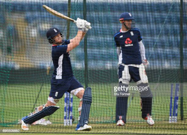 England batsman Jonny Bairstow hits out as Alex Hales looks on during England nets ahead of their ICC Champions Trophy match against Pakistan at...