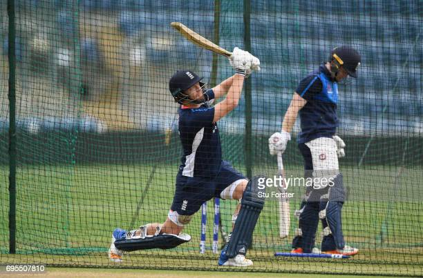 England batsman Jonny Bairstow hits out as captain Eoin Morgan looks on during England nets ahead of their ICC Champions Trophy match against...