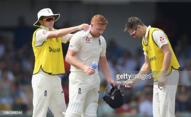 England batsman Jonny Bairstow is cooled down in the heat by 12th men Sam Curran and Chris Woakes during Day One of the Third Test match between Sri...