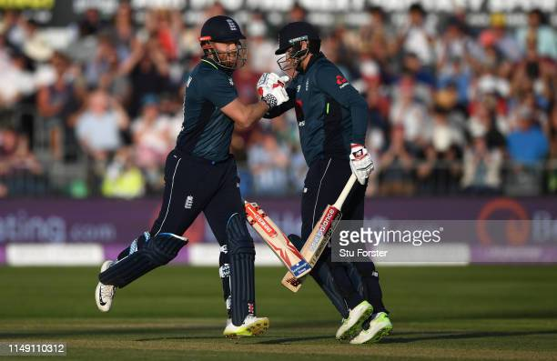 England batsman Jonny Bairstow reaches his century and celebrates with Joe Root during the 3rd Royal London ODI match between England and Pakistan at...
