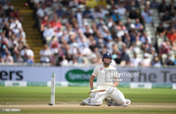 England batsman Jonny Bairstow reacts as the ball goes through off his glove to be caught by Cameron Bancroft during the fifth day of the 1st Test...