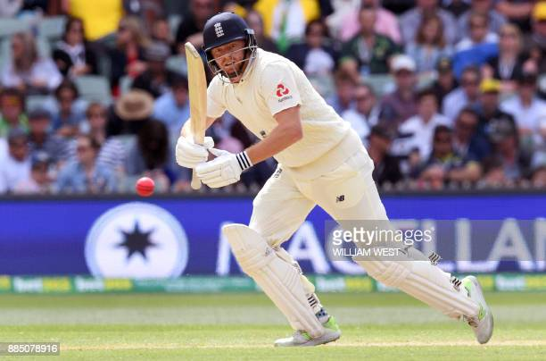 England batsman Jonny Bairstow steers a ball away from the Australian bowling on the third day of the second Ashes cricket Test match in Adelaide in...