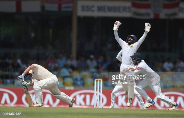 England batsman Jonny Bairstow survives a confident appeal for caught behind by wicketkeeper Niroshan Dickwella during Day One of the Third Test...