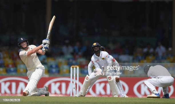 England batsman Jonny Bairstow sweeps the ball for six runs watched by Niroshan Dickwella during Day One of the Third Test match between Sri Lanka...