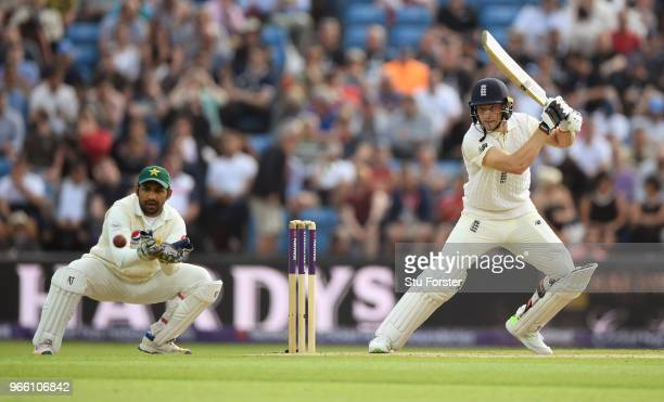 England batsman Jos Buttler cuts a ball watched by wicketkeeper Sarfraz Ahmed during day two of the second test match between England and Pakistan at...