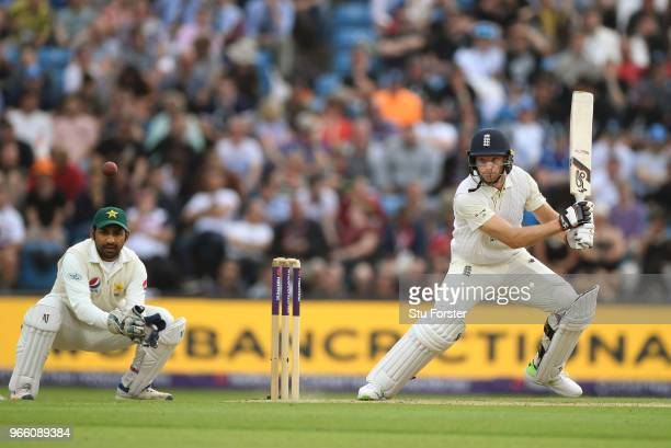 England batsman Jos Buttler drives watched by wicketkeeper Sarfraz Ahmed during day two of the second test match between England and Pakistan at...