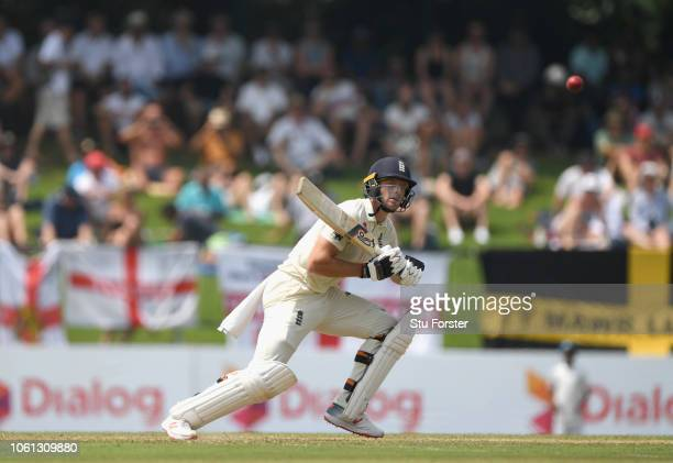 England batsman Jos Buttler hits out during Day One of the Second Test match between Sri Lanka and England at Pallekele Cricket Stadium on November...