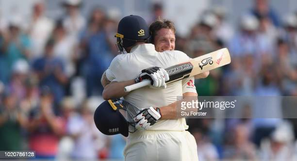 England batsman Jos Buttler is congratulated by Ben Stokes after reaching his century during day four of the 3rd Specsavers Test Match between...