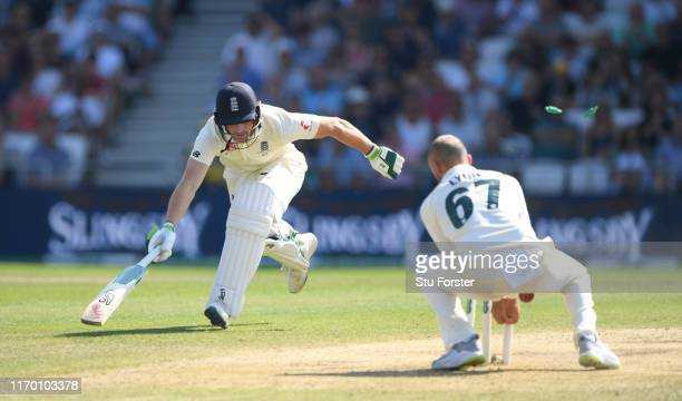 England batsman Jos Buttler is run out from a direct throw from Travis Head as Nathan Lyon looks on during day four of the 3rd Ashes Test Match...