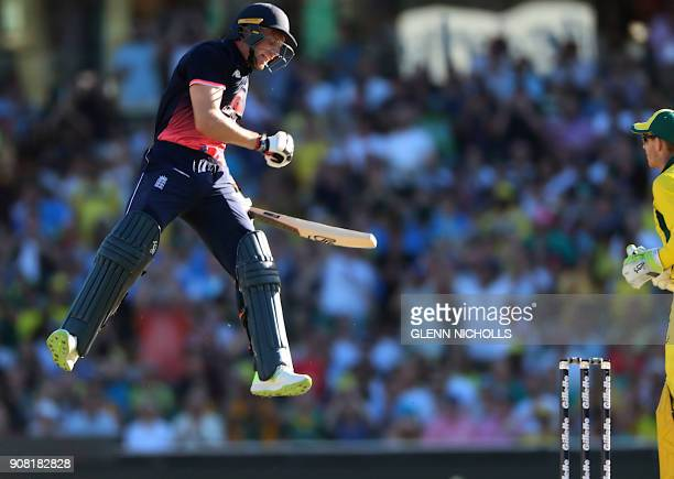 TOPSHOT England batsman Jos Buttler jumps for joy as he reaches his century during the third oneday international cricket match between England and...