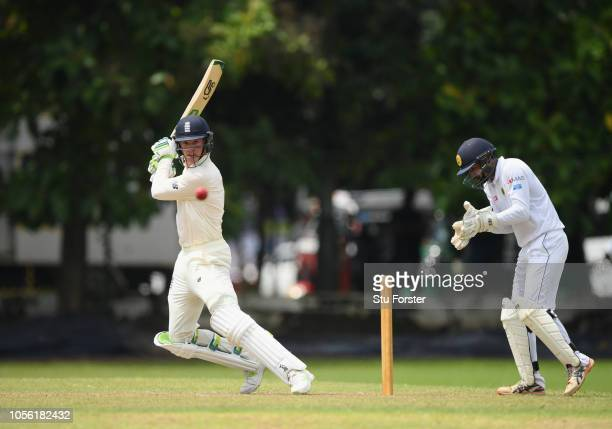 England batsman Keaton Jennings cuts a ball to the boundary watched by Sri Lanka wicketkeeper Manoj Sarathchandra during the Tour match between Sri...
