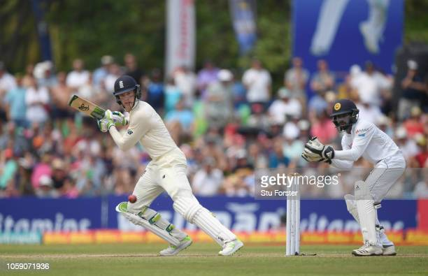 England batsman Keaton Jennings cuts the ball to pick up some runs watched by Sri Lanka wicketkeeper Niroshan Dickwella during Day three of the First...