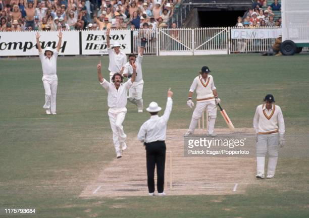 England batsman Keith Fletcher is caught behind for 1 run by Rodney Marsh of Australia off the bowling of Dennis Lillee during the Centenary Test...
