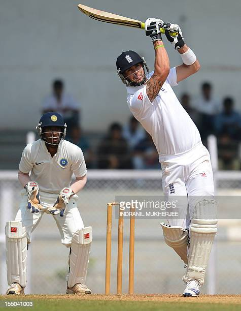 England batsman Kevin Pietersen bats as India 'A' wicketkeeper Wriddhiman Saha watches during the second day of a three day practice match between...