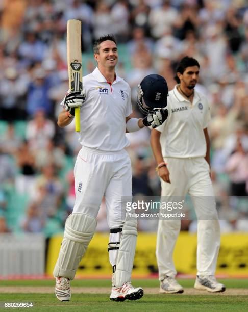 England batsman Kevin Pietersen celebrates reaching his century as he moves past India's Ishant Sharma during the 4th Test match at the Oval cricket...
