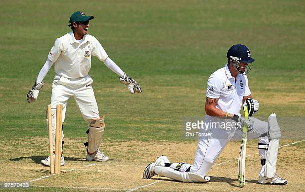 England batsman Kevin Pietersen looks on after being bowled for 20 runs as Bangladesh wicketkeeper Saghir Hossain celebrates during day three of the...