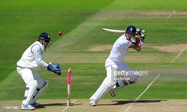 England batsman Kevin Pietersen picks up some runs watched by MS Dhoni of India during day two of the 1st npower test match between England and India...