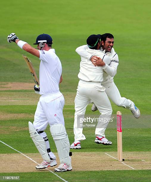 England batsman Kevin Pietersen points to his bat as MS Dhoni of India celebrates his wicket but on referral is given not out during day two of the...