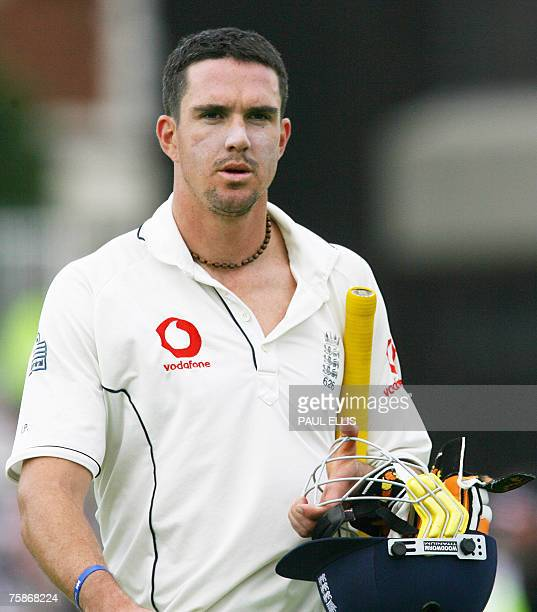 England batsman Kevin Pietersen returns to the pavillion after being dismissed lbw by India's K.P. Singh for 19 runs at Trent Bridge in Nottingham,...