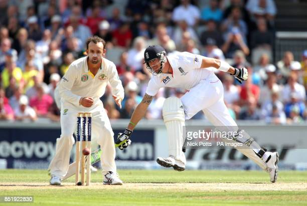 England batsman Kevin Pietersen runs between the wickets to beat a throw into Australia's Nathan Lyons from David Warner during day three of the...