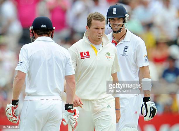 England batsman Kevin Pietersen smiles at Australian paceman Peter Siddle as teammate Paul Collingwood looks on during the third day of the second...