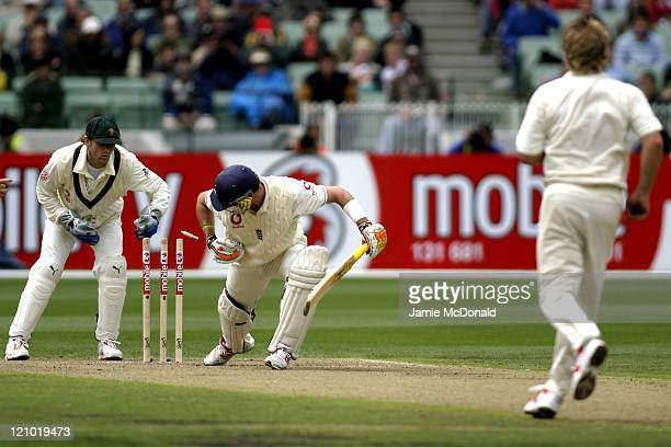 England batsman Kevin Pietersen survives a stumping attempt by Adam Gilchrist as Shane Warne watches on in Day One of the Fourth Ashes Test at the...