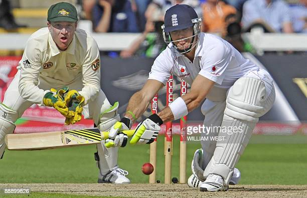 England batsman Kevin Pietersen sweeps only to be caught off the bowling of Australian spinner Nathan Hauritz as wicketkeeper Brad Haddin looks on...