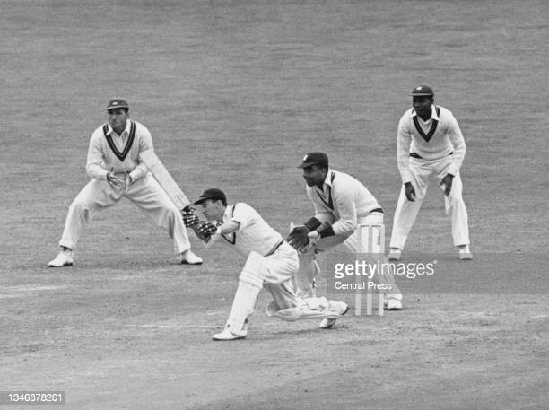 England batsman Leonard Hutton plays a cover drive shot off a delivery by Alf Valentine during the second innings of the Fourth Test match against...
