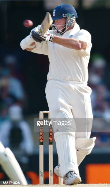 England batsman Marcus Trescothick hooks a delivery from Australian speedster Glen McGrath on the second day of the first Test Match at the Gabba in...
