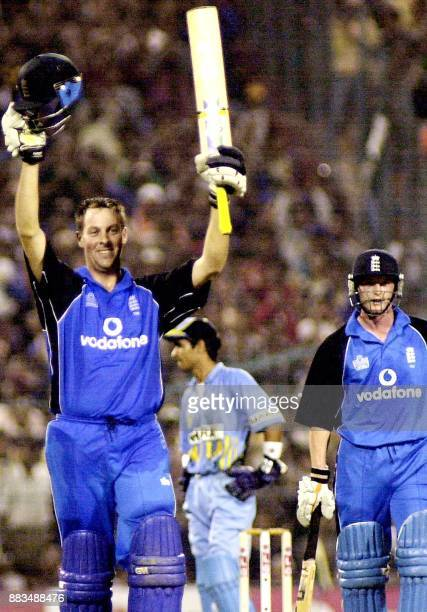 England batsman MarcusTrescothick waves after scoring as Paul Collingwood stands beside him during the first of the OneDayInternational Series...