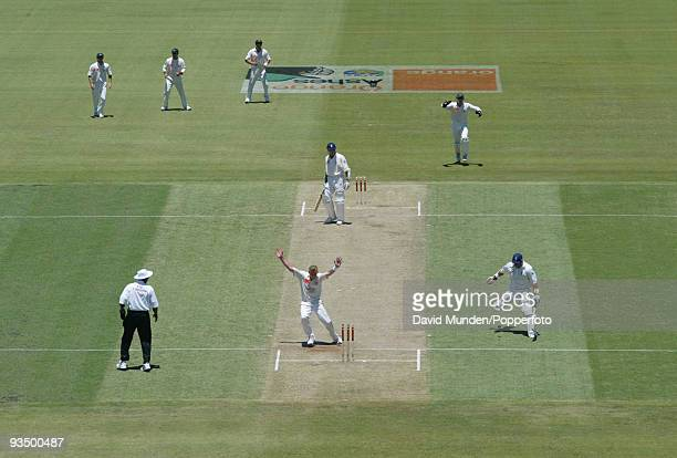 England batsman Mark Butcher is run out by a direct hit thrown by the Australian captain Steve Waugh as Brett Lee celebrates on the first day of the...