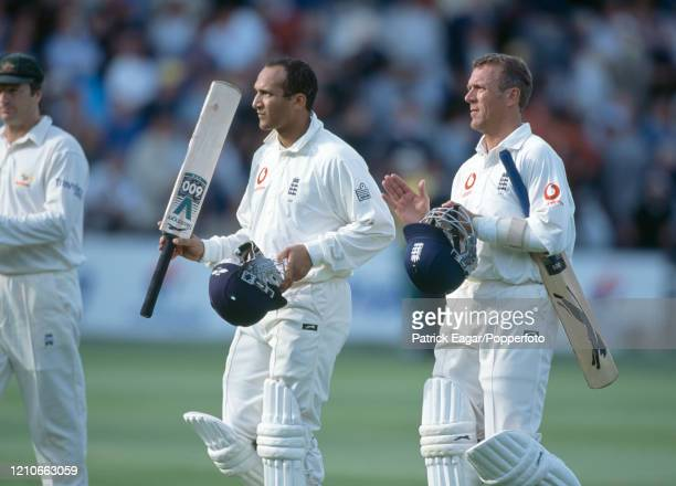 England batsman Mark Butcher raises his bat as he leaves the field on 73 not out with teammate Alec Stewart at the end of day three of the 2nd Test...