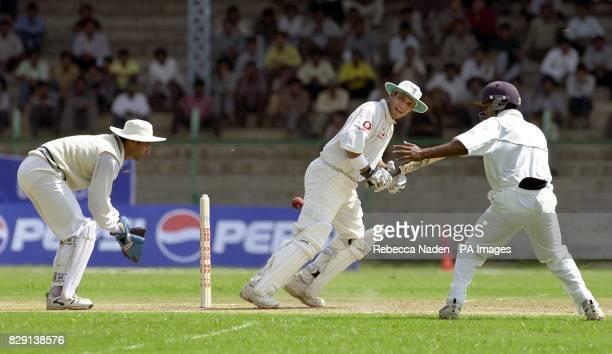 England batsman Mark Butcher scores four runs watched by Board President's XI wicketkeeper Pankaj Dharmani and fielder Wasim Jaffer during the first...