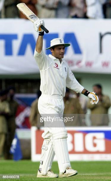 England batsman Mark Ramprakash raises his bat in the air after competing his century during their three day match against the President's Board XI...