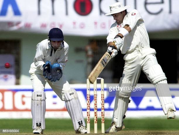 England batsman Mark Ramprakash square cuts a ball as keeper Pankaj Dharmani look on during their three day match against India's Board President's...