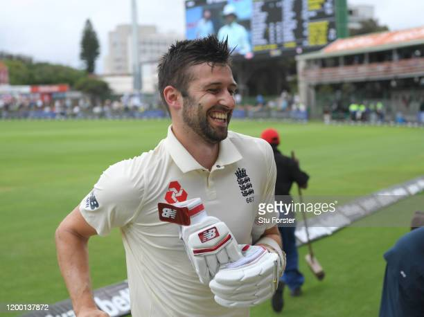 England batsman Mark Wood smiles as he comes off the field after his splendid cameo innings of 42 runs during Day Two of the Third Test between South...