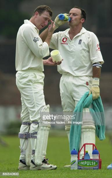 England batsman Michael Atherton applies vaseline to his eyebrows to prevent sweat runnung into his eyes as captain Nasser Hussain takes a drink...