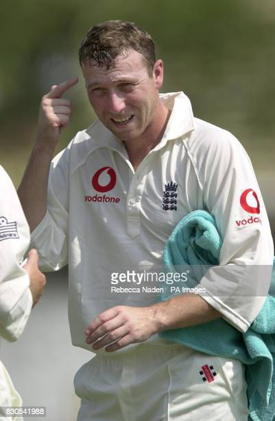 England batsman Michael Atherton applies vaseline to his eyebrows to prevent sweat running into his eyes during the match against a Board Presidents...
