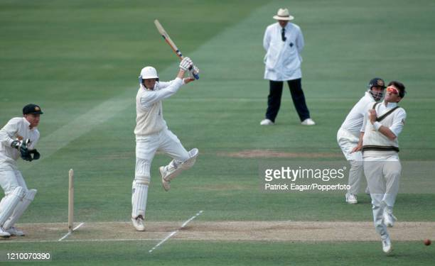 England batsman Mike Atherton drives the ball past Mark Waugh of Australia during his innings of 99 runs as England follow on in the 2nd Test match...