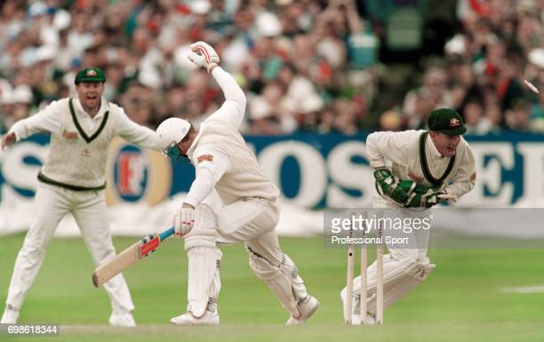 England batsman Mike Atherton is stumped for 63 by Australia's wicketkeeper Ian Healy during the 4th Test match between England and Australia at...