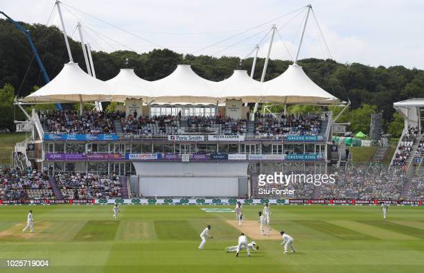 England batsman Moeen Ali is caught by slip fielder Rahul off India bowler Ishant Sharma during day three of the 4th Specsavers Test between England...