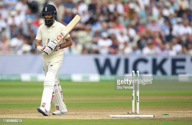 England batsman Moeen Ali leaves the field after being bowled for 0 during Day three of the First Specsavers Test Match at Edgbaston on August 03,...