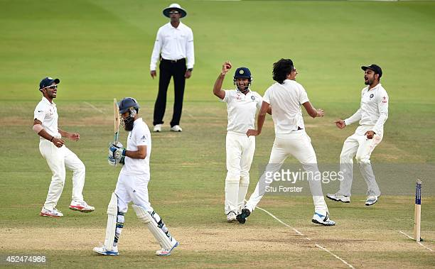 England batsman Moeen Ali walks off after being caught by India fielder Cheteshwar Pujara off bowler Ishant Sharma during day five of 2nd Investec...