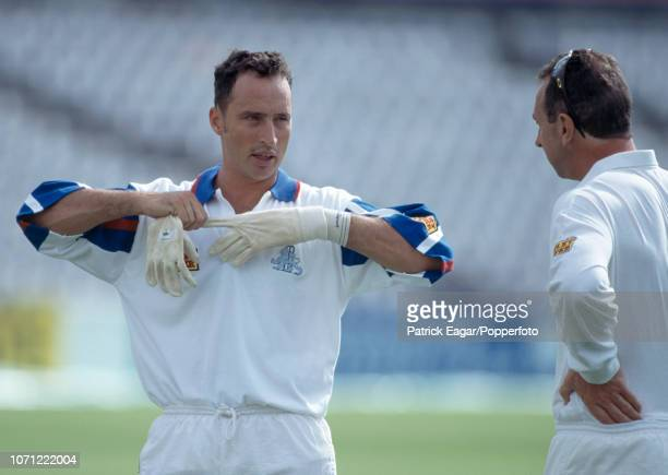 England batsman Nasser Hussain talks with team coach David Lloyd during a nets session before the 3rd Test match between England and Pakistan at The...