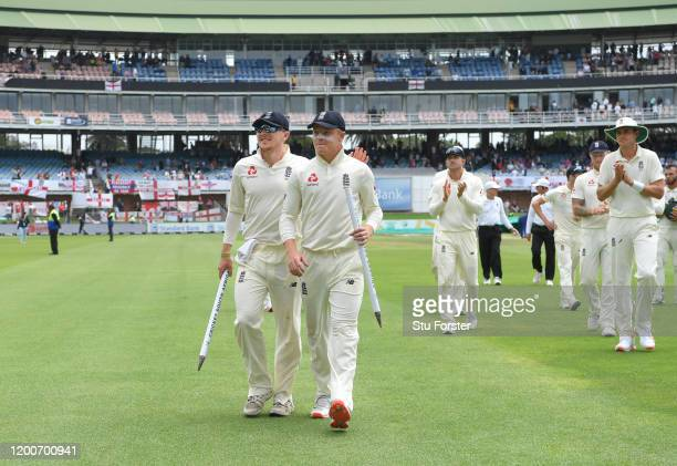 England batsman Ollie Pope and man of the match leads the team off the field with spinner Dom Bess after Day Five of the Third Test between South...
