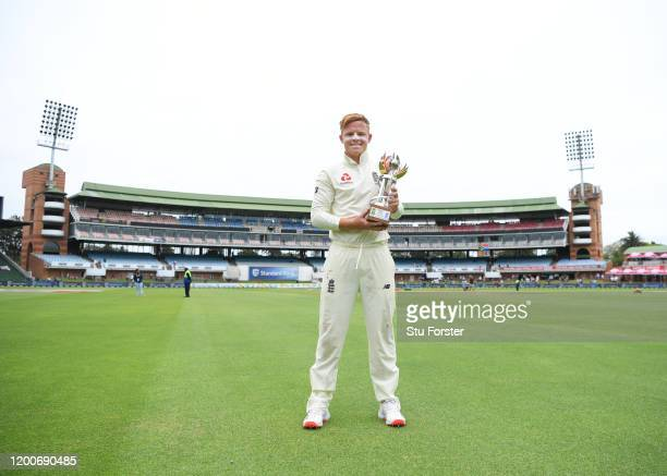 England batsman Ollie Pope with his man of the match award after Day Five of the Third Test between South Africa and England at St George's Park on...