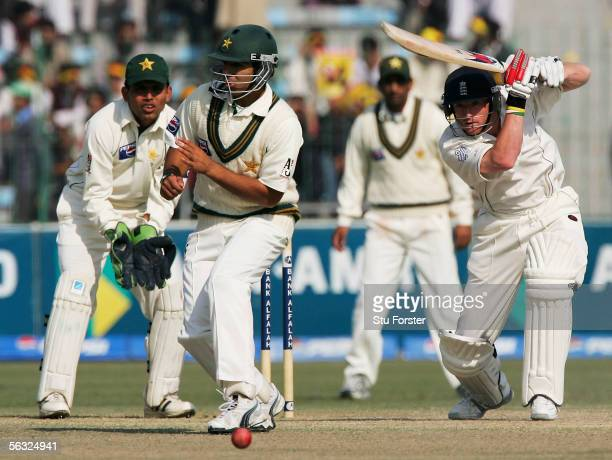 England batsman Paul Collingwood drives the ball past Pakistan short leg fielder Salman Butt during the Fifth and Final Day of the Third and Final...