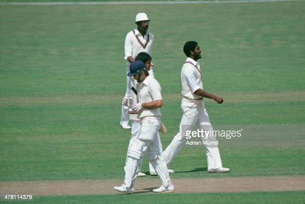 England batsman Peter Willey walks away from the crease after being bowled out by Michael Holding during the Second Test against the West Indies at...
